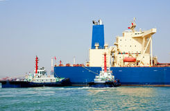 Oil tanker and tugboats royalty free stock images