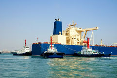 Oil tanker and  tugboats Stock Image