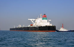 Oil tanker and  tugboats Stock Photography