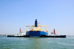 Oil tanker and two tugboats stock images