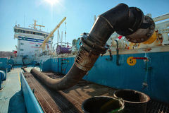 Oil tanker under load. Pumping oil in the tank Stock Images