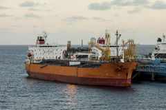 Oil tanker unloading at sea Royalty Free Stock Photo