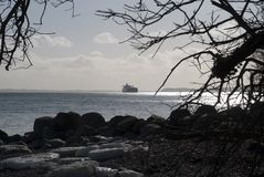 Oil tanker and winter beach Stock Photo