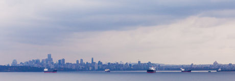 Oil tankers anchor Vancouver skyline BC Canada Stock Image