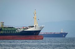 Oil tankers at an anchorage. Close-up of Oil tankers at an anchorage, Greece royalty free stock images