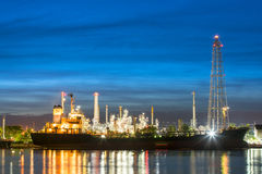 Oil tankers In front of a refinery Stock Image