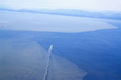 Oil tankers off the coast of British Columbia. Heading toward US royalty free stock photo