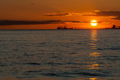 Oil tankers at sunset Stock Images