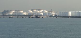 Oil tankers in unloading oil tank, oil continuously flows into the storage tanks Royalty Free Stock Photo