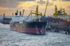 Oil tankers unloading Royalty Free Stock Photos