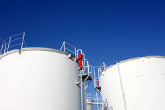 Oil tanks. And blue sky Stock Photo