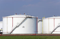 Oil tanks. White oil tanks in a refinery with blue sky Royalty Free Stock Photo