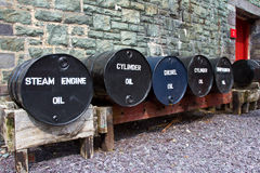 Oil tanks. At Welsh National Slate Museum, Llanberis in Snowdonia national park, Wales Stock Images