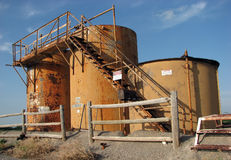 Oil tanks. Tanks at a drilling site Stock Photos