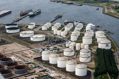 Oil Tanks. Along the Maas River in the port of Rotterdam.  The port of Rotterdam is the largest port and industrial complex in Europe with a total cargo Stock Photos