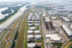 Oil Tanks. Along the Maas River in the port of Rotterdam.  The port of Rotterdam is the largest port and industrial complex in Europe with a total cargo Royalty Free Stock Photos