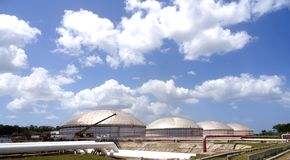 Oil tanks and crane. Oil tanks at Matanzas Bay, Cuba Stock Photography