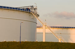 Oil tanks in the evening light Stock Photo