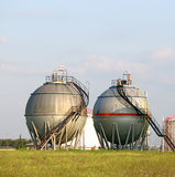 Oil tanks on field Stock Image
