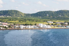 Oil Tanks Between Green Hills and Blue Sea Royalty Free Stock Image
