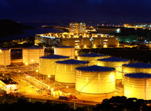 Oil tanks at night Stock Image