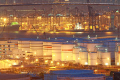 Oil tanks at night in container terminal Stock Photo