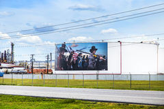 Oil tanks are painted with historic Royalty Free Stock Images