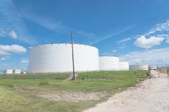 Oil tank farm in Pasadena, Texas, USA. Oil tanks in a row under blue sky in Pasadena, Texas, USA. Large white industrial tank for petrol, oil, natural gas Royalty Free Stock Photo