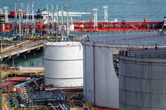 Oil tanks and ship at day Stock Photos