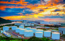 Oil tanks at sunset Stock Images
