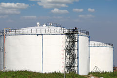 Oil tanks and workers Royalty Free Stock Image