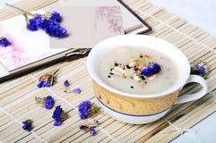 Oil-tea. A cup of Oil-tea on the table Royalty Free Stock Photos