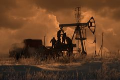Oil team. Workers repair oil production of winter Royalty Free Stock Photos