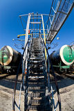 Oil terminal. Rail cars parked at oil terminal filling station. Fisheye royalty free stock photos