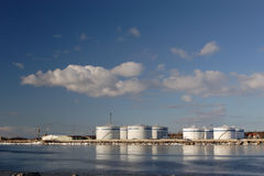 Oil terminal in the harbour. Oil terminal with storage tanks in the harbour Royalty Free Stock Photography
