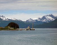 The oil terminal at valdez. A barge working at the end of the alaska pipeline Royalty Free Stock Images