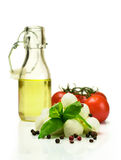 Oil , tomatoes, mozzarella and basil isolated on white Royalty Free Stock Photos