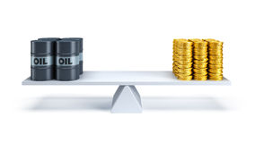 Oil trading concept. Black oil barrels and money counterbalance each other on the scales Royalty Free Stock Image