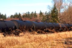 Oil Train. Several oil tanker train cars on the tracks royalty free stock photos