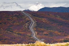 Oil Transport Alaska Pipeline Cuts Across Rugged Mountain Landsc Stock Image