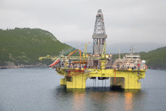 Oil trust in middle of river in Bergen Stock Images