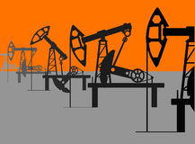 Oil units at work in perspective. Royalty Free Stock Photos