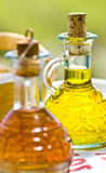 Oil & Vinegar. Greek table setting, all courses are supplied with olive oil and vinegar bottles royalty free stock photography