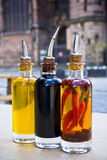 Oil and vinegar. Bottles with oil and vinegar of a restaurant in Berlin Royalty Free Stock Image