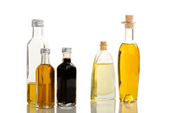 Oil and vinegar assortment. Five bottles of oil and vinegar in different outline and color Stock Photos