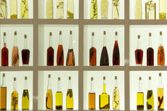 Oil and vinegar bottles with herbs Royalty Free Stock Photo