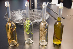 Oil and vinegar bottles with herbs Royalty Free Stock Photos