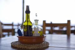Oil and vinegar on table at beach bar, backlight Royalty Free Stock Photos