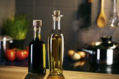 Oil and vingar bottles in front of a kitchen Stock Photo