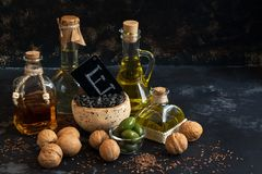 Oil with vitamin E. Linseed oil, olive oil, sunflower oil, walnut oil. Selective focus. Concept. Oil with vitamin E. Linseed oil, olive oil, sunflower oil royalty free stock photos